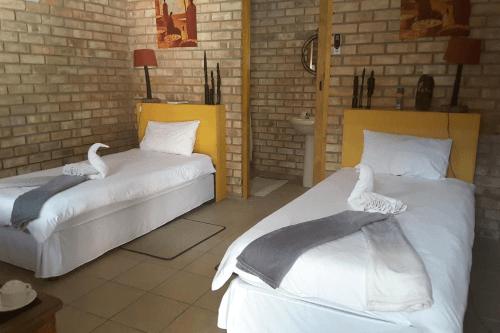 melissa  guest house kamer 2 aparte bedden.png