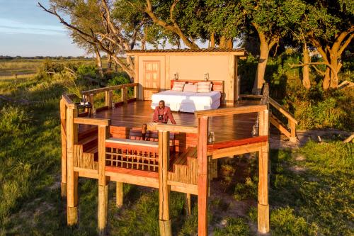 camp okavango sleep out deck.png